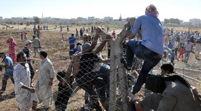 Telleri yıkıp Kobani'ye geçtiler!