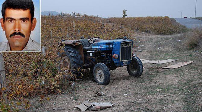 Baba oğul, devrilen traktörde can verdi