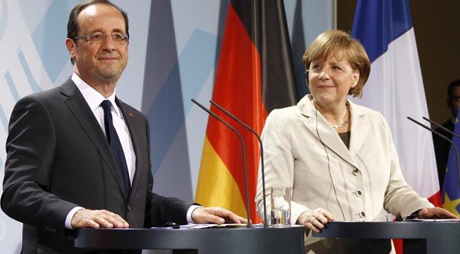 Merkel ve Hollande yarın Yunanistan'ı görüşmek için bir araya geliyor