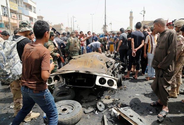 People gather at the scene of a car bomb attack in Baghdad's mainly Shi'ite district of Sadr City, Iraq, May 11, 2016. REUTERS/Wissm al-Okili