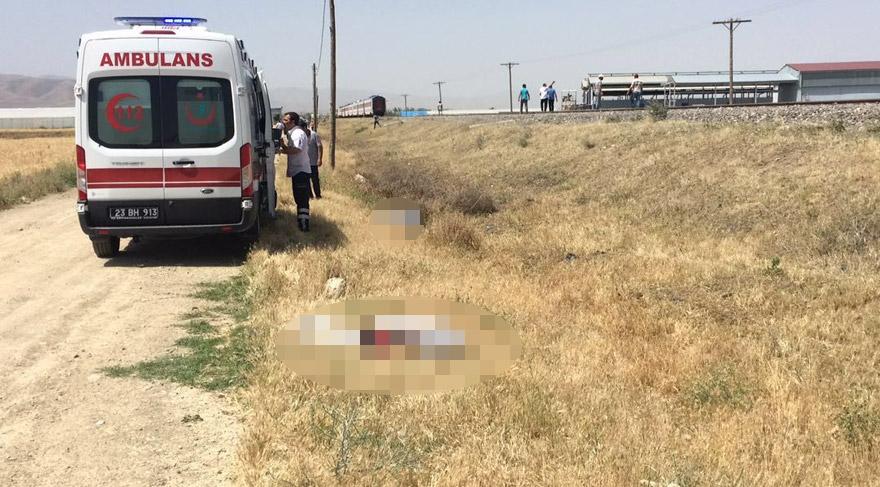 FOTO:İHA - Trenin minibüsü yaklaşık 200 metre sürüklediği gözlendi.