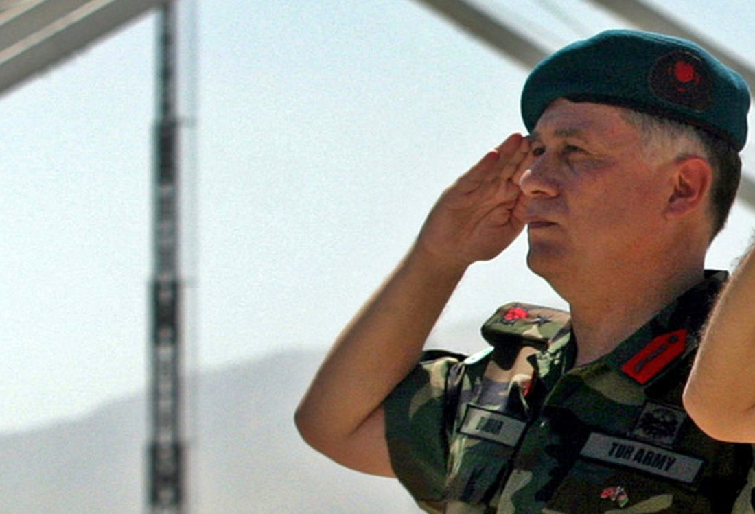 FILE PHOTO - Turkish Brigadier General Umit Dundar salutes during a handover of command of the Kabul Multinational Brigade in Kabul, Afghanistan July 20, 2005. REUTERS/Ahmad Masood/File Photo