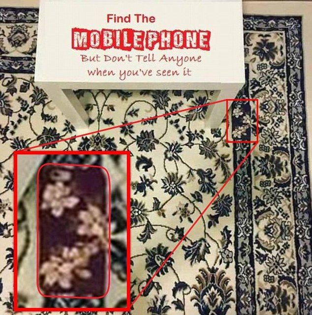 Find the mobile phone on the carpet