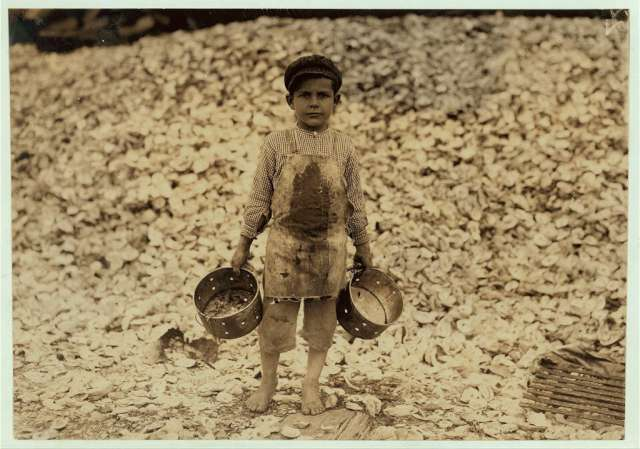 manuel-the-young-shrimp-picker-5-years-old-and-a-mountain-of-child-labor-oyster-shells-behind-him-he-worked-the-year-before-understands-not-a-word-of-english-dunbar-lopez-dukate-company-location-biloxi-m