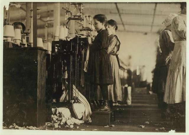 this-little-girl-like-many-others-in-this-state-is-so-small-she-has-to-stand-on-a-box-to-reach-her-machine-she-is-regularly-employed-as-a-knitter-in-a-hosiery-mill-said-she-did-not-know-how-long-she-had-