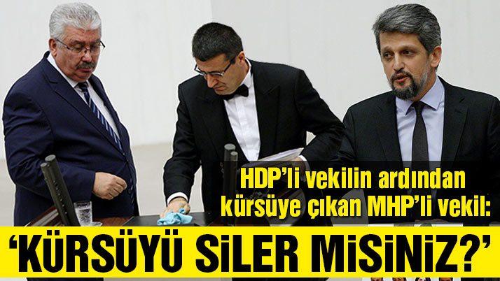 HDP'li vekil kürsüye vurdu, MHP'li vekil masayı sildirdi