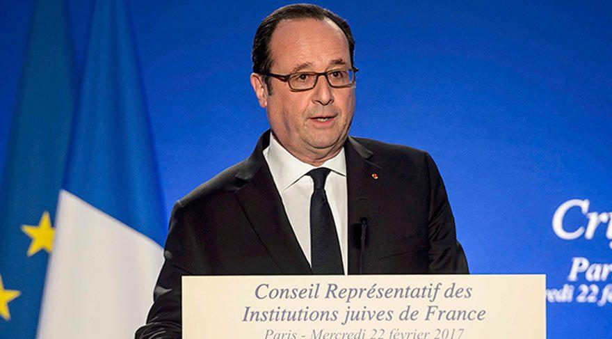 Fransa Cumhurbaşkanı Hollande konuşurken keskin nişancının silahı ateş aldı