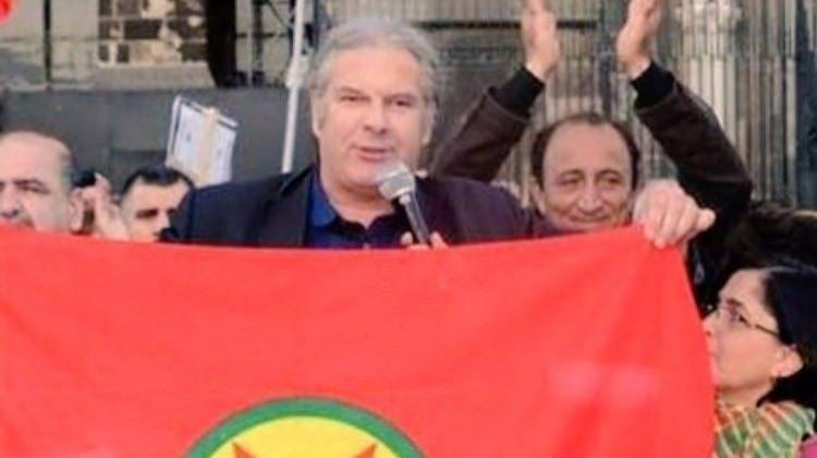 Erdoğan, Avrupa Konseyi seçim gözlemciler heyeti üyesi olarak Türkiye'ye gelen Andrej Hunko'nun PKK sözde bayrağı ile fotoğrafını gösterdi.