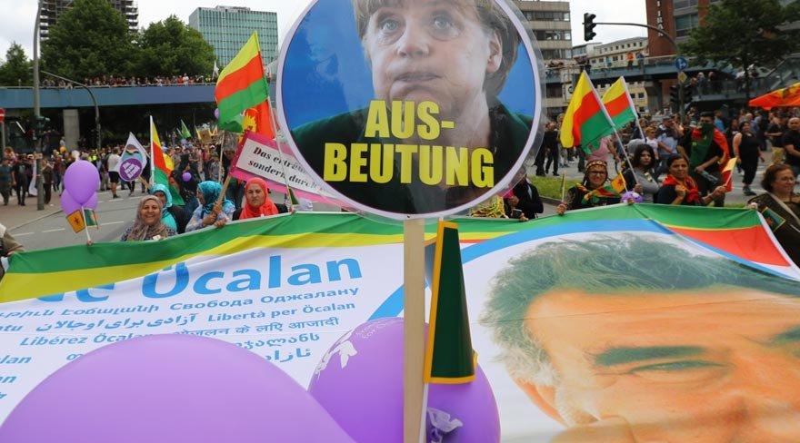 G20'yi bebek katilinin posteriyle protesto ettiler
