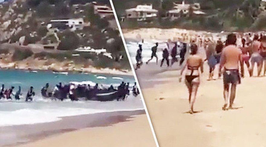 Güneşlenen turistlere göçmen şoku