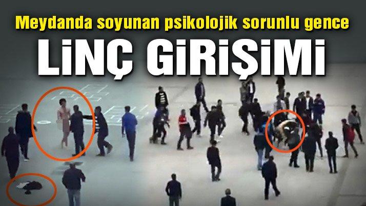 Yozgat'ta meydanda soyunan genci, linçten polis kurtardı
