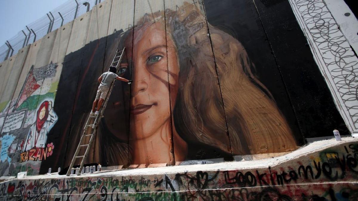 İsrail'den bir garip hamle: Direnişin sembolü serbest, onu çizen içerde
