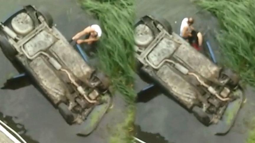 Irmağa atlayarak otomobildeki aileyi kurtardı