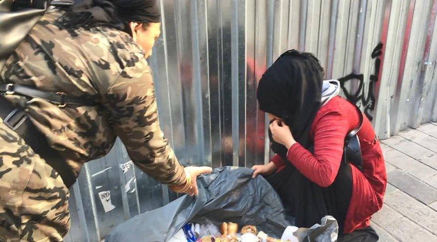 Çöpten yemek yiyormuş gibi yaparak insanların duygularını sömüren kadın tepki çekti. Foto: DHA