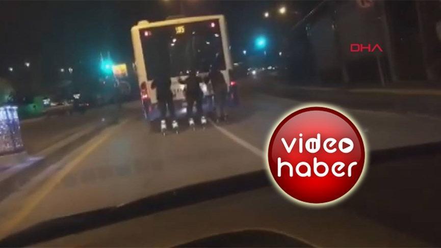 Ankara'da patenli gençlerin otobüsün arkasında tehlikeli yolculuğu