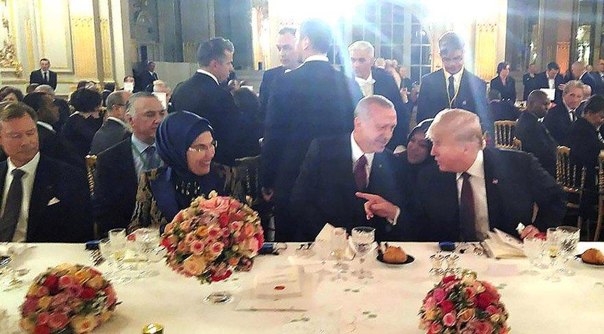 Trump ile Erdoğan yan yana oturdu. AA
