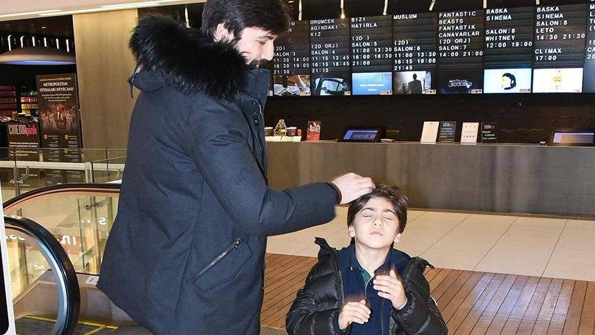 Tolga'dan oğluna poz ayarı