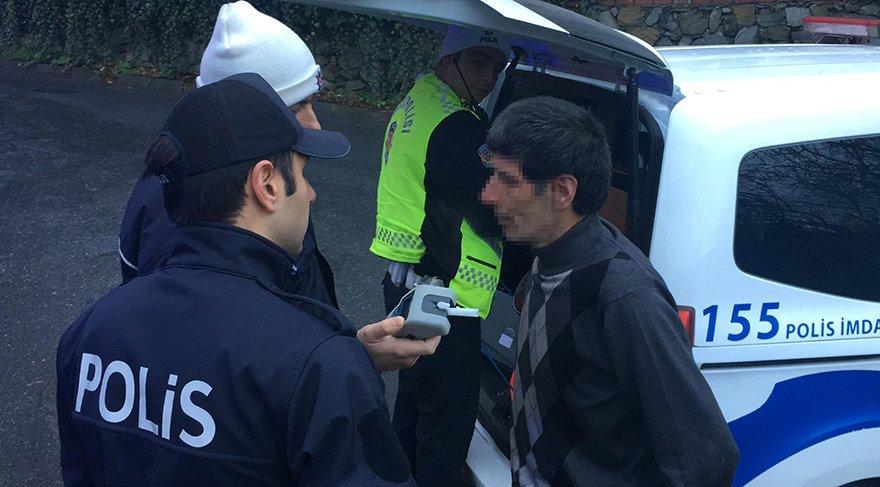 Genç kadını darp eden ve alkollü olduğu tespit edilen şahıs polis ekipleri tarafından gözaltına alındı. Foto: DHA
