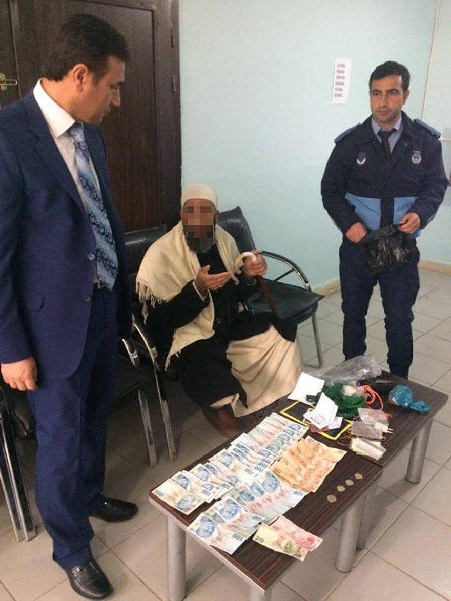 Şanlıurfa'nın Viranşehir ilçesinde zabıta ekiplerince yakalanan 2 dilencinin üzerinde yaklaşık 10 bin lira çıktı. FOTO:DHA