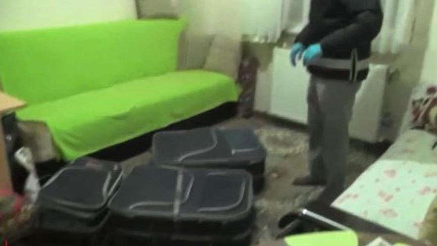 Polis aparta baskın yaptı, bavul dolusu ele geçirildi