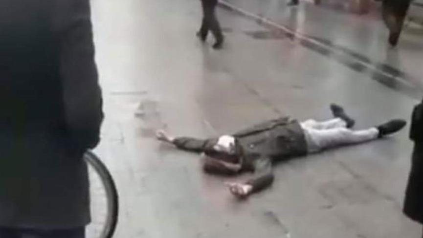 Maskeli adam yere yığılınca corona virüsü paniği yaşandı