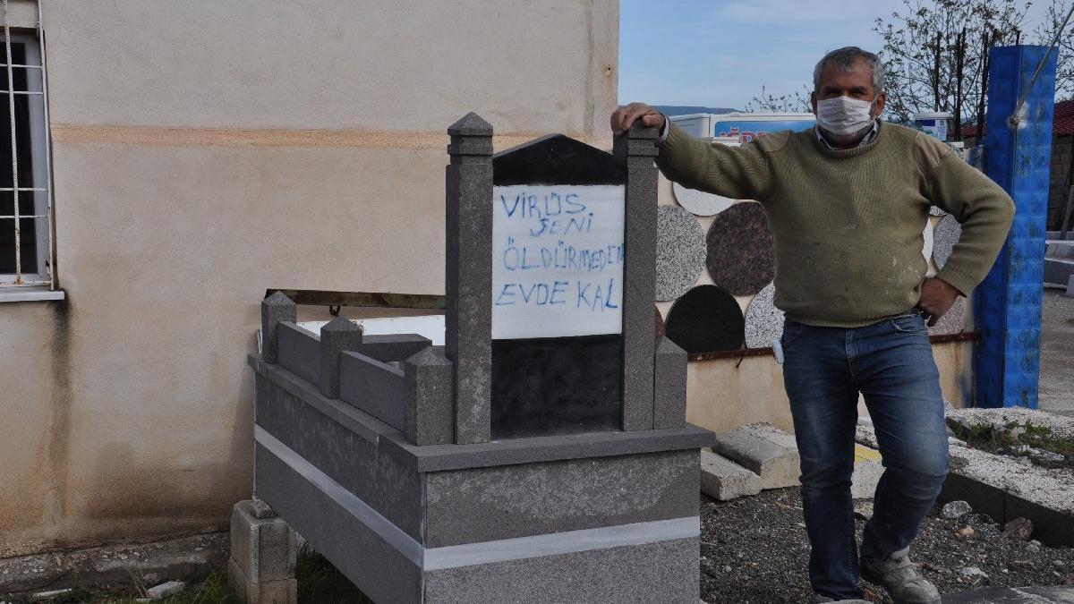 Corona virüsüne karşı mezar taşlı uyarı