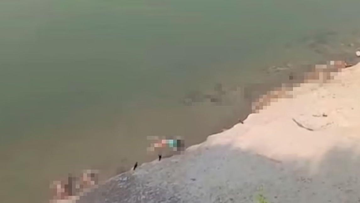 Covid-19'un merkez üssünde korkunç görüntü: Ölenlerin cesetleri nehirden çıktı