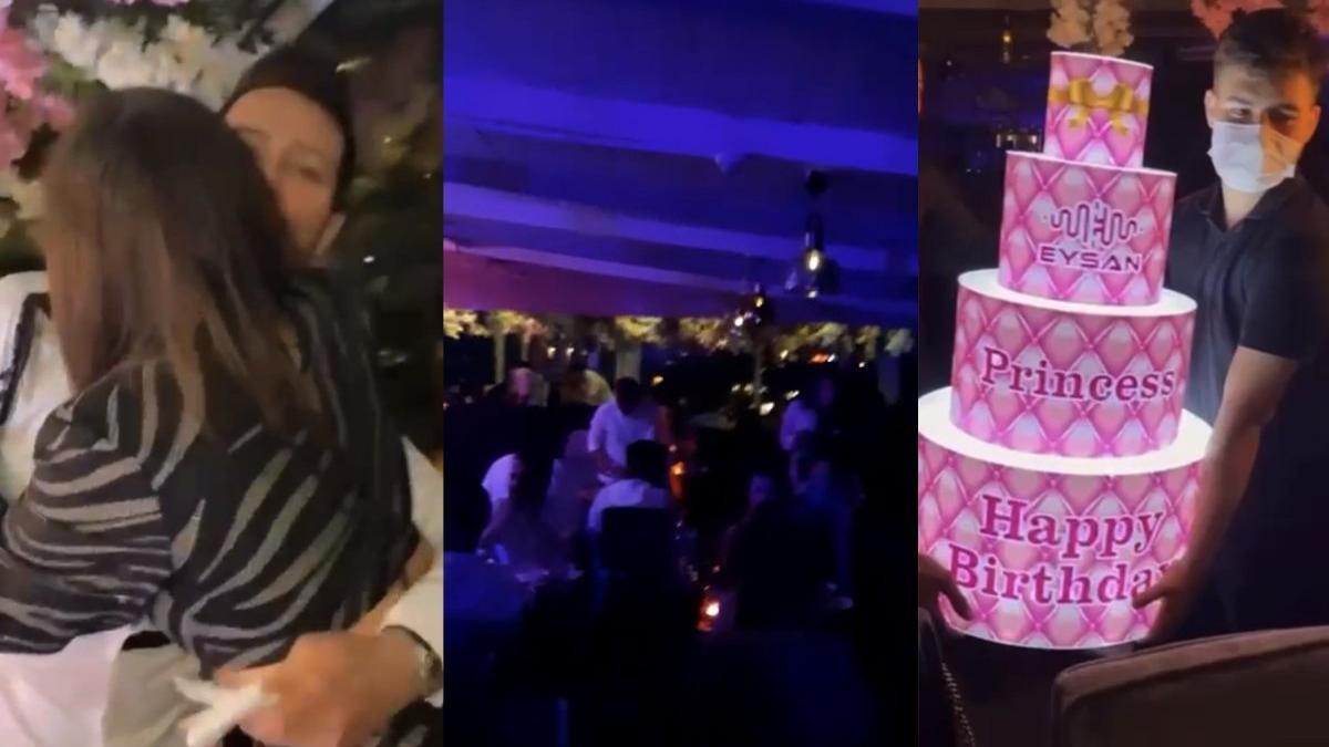 Otel terasında meşaleli doğum günü partisi