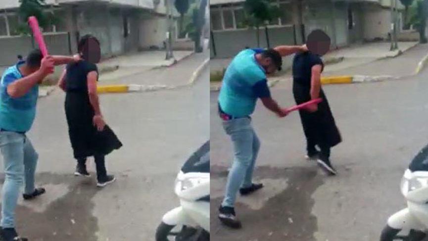 Eşini taciz eden kişiye iç çamaşırı giydirip dövdü