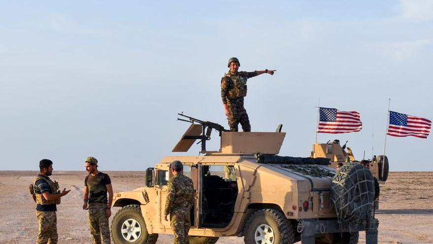 Teröristler göğüslerinde ABD arması ile geziyor