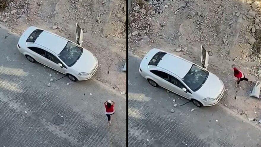 Öfkeli kadın hıncını arabadan çıkardı