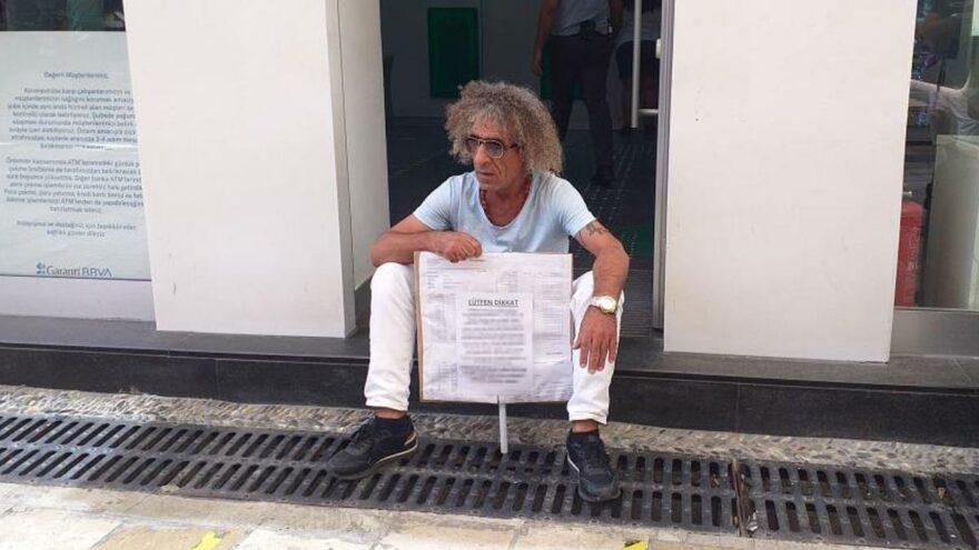 Kartından 10 bin lira çekildi, bankada eylem yaptı