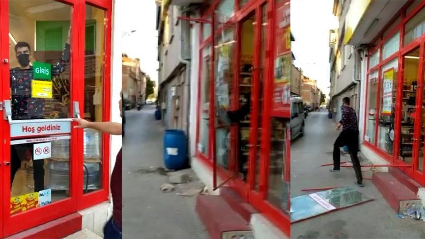 Markete kilitlenen hırsız camı kırarak kaçtı